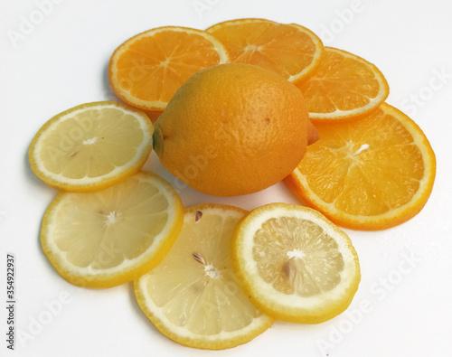 Lemon, ginger and orange slices on white background. Sliced fruit isolated. Healthy food concept.