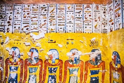 Fotografia, Obraz Burial chamber with colorful Egyptian hieroglyphics at the valley of the kings,