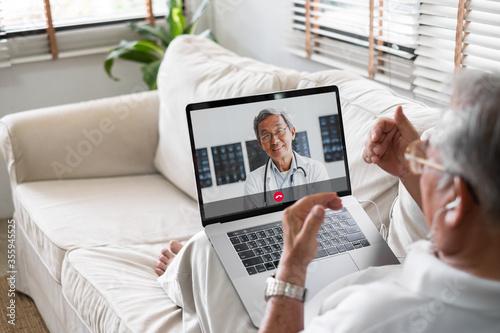 Slika na platnu Asian senior video call with doctor telemedicine telehealth concept