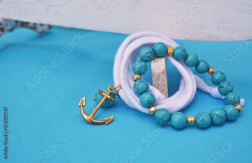 Obraz na płótnie summer jewelry - turquoise gemstone bracelet and gold anchor charm