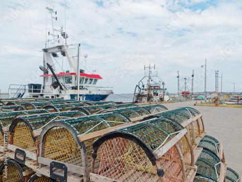 Obraz na plátně Lobster traps and fishing boats at Grande-Entrée pier, Magdalen Islands