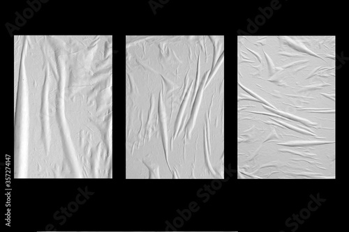 Wallpaper Mural Three white crumpled sheets of paper on a black background.