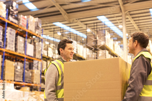 Tela Workers carrying box in warehouse