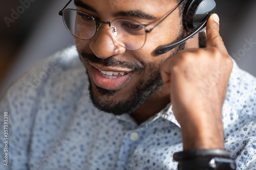 Fotografía Close up face african man telesales worker working wear headset contacting customers to inform them about service, answer questions about products