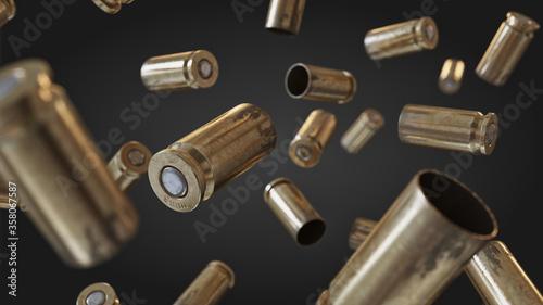 Fotografia Flying bullet shells on a black studio background