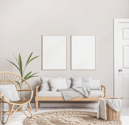 Fotografia Mock up frame in trendy farmhouse interior with wider furniture, rattan armchair