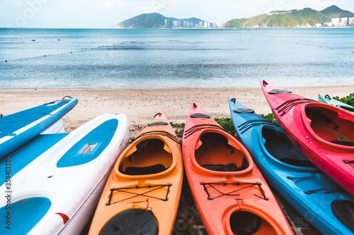 Fotografija Coloured canoe boats on the seashore, outdoor activities at the resort in summer