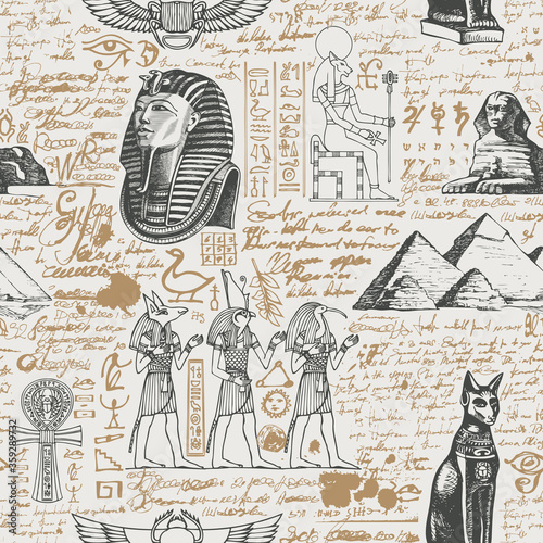 Wallpaper Mural Ancient Egypt seamless pattern with hand-drawn Egyptian gods and unreadable scribbles in retro style