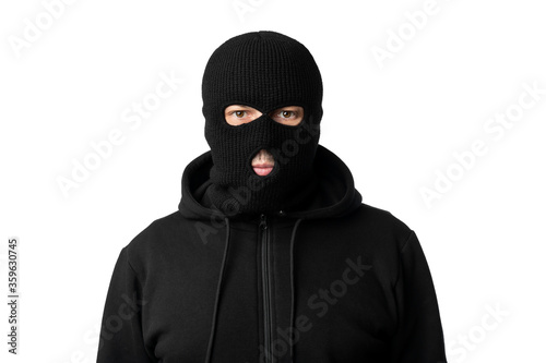 Wallpaper Mural Portrait of masked thief isolated over white studio wall
