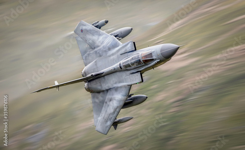 Obraz na płótnie RAF (Royal Air Force) Panavia Tornado GR4 Fighter Bomber and reconnaissance jet flying low level in the UK, Cumbria, Wales and Scotland