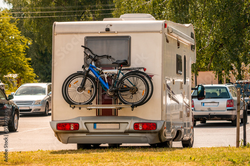 Two pleasure bikes are strapped to the back of the camper van Fototapeta