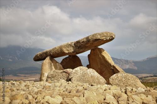 Fotografie, Tablou Closeup shot of Dolmen named Shack of the Sorceress in Laguardia, Alava, Spain