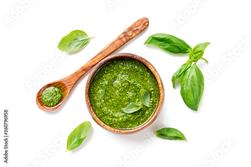 Fototapeta Traditional italian sauce pesto with green basil in wooden bowl isolated on whit