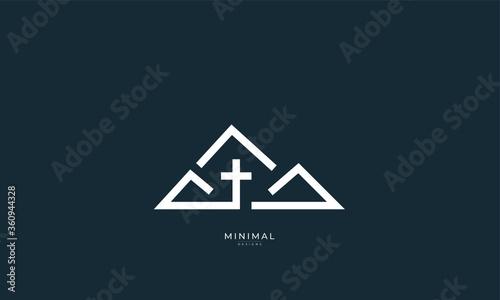 Fotografia A minimal abstract icon logo of a mountain with a Cross, church