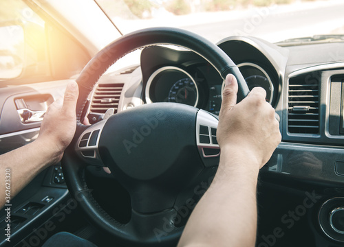 Photo Cropped Hands Of Man Holding Steering Wheel