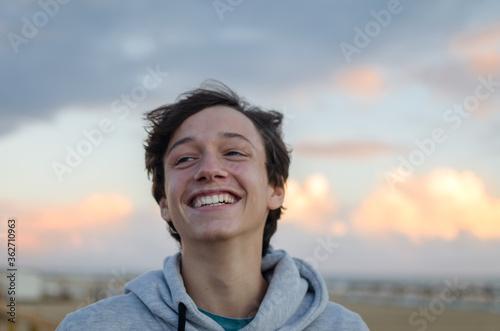 Smiling Teenage Boy Looking Away At Beach Fototapeta