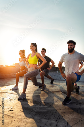 Slika na platnu Portrait of smiling fit happy people doing power fitness exercise