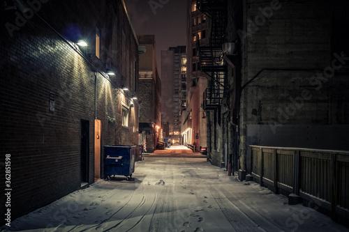 Murais de parede Empty Alley Amidst Buildings At Night
