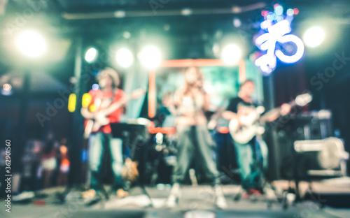Defocused Image Of People Enjoying In Music Concert Fotobehang