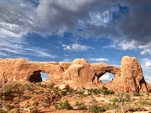 Fotografie, Obraz Rock Formations Against Cloudy Sky, Arches National Park