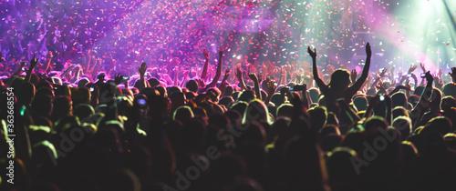 Billede på lærred A crowded concert hall with scene stage lights, rock show performance, with peop
