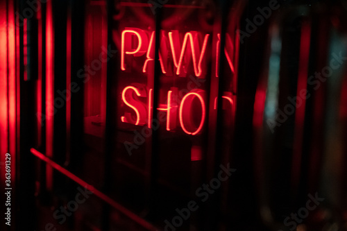 A Neon Sign Saying Pawn Shop Viewed Through The Window Of A Door Fototapet