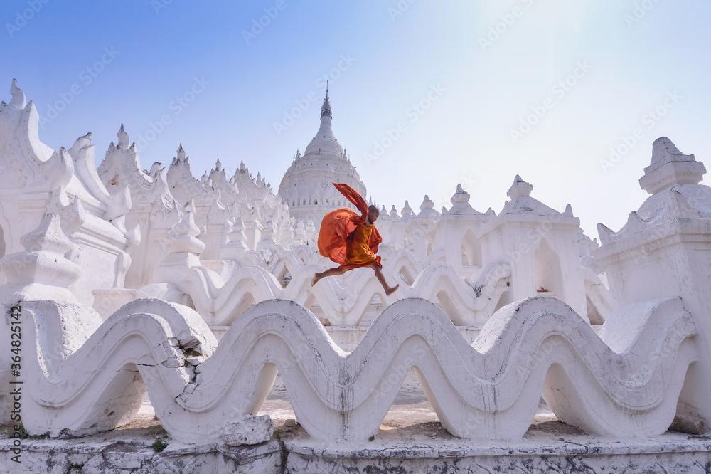 Boy playing outside pagoda
