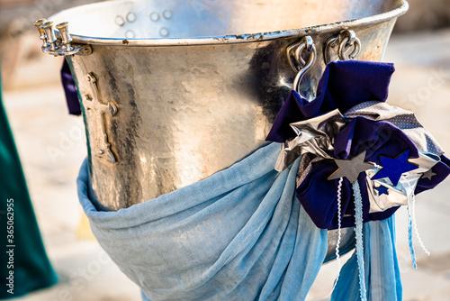 Billede på lærred Decoration element with stars and  dark blue stripes  on the metal baptismal font