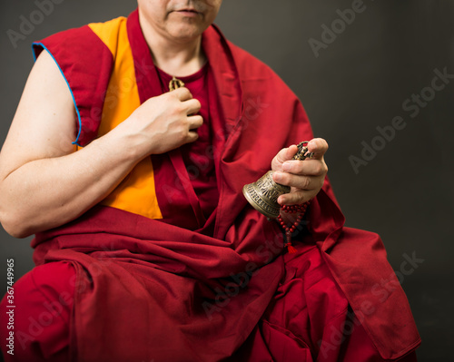 Slika na platnu Tibetan Buddhist monk teacher in a burgundy yellow outfit suit