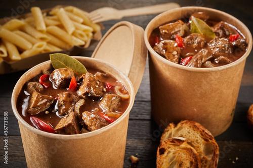 Obraz na plátně Two servings of takeaway beef goulash in tubs