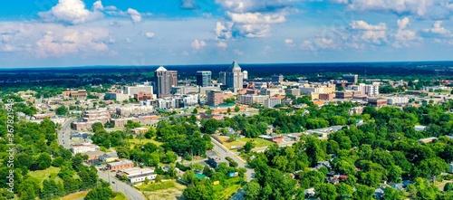 Fotografie, Obraz Aerial shot of the skyline of Greensboro located in North Carolina, USA, on a pa