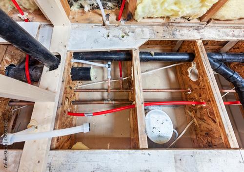 Tela Bathroom remodel showing under floor plumbing work connecting old copper pipes t