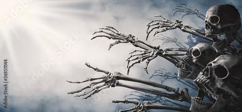 Photographie Zombie skeleton hand rising in dark Halloween night.