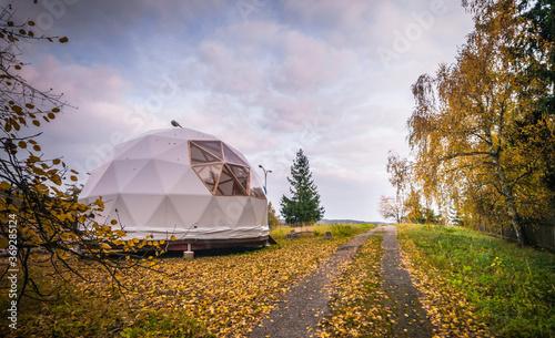 Obraz na płótnie Large geodesic dome tent in autumn forest