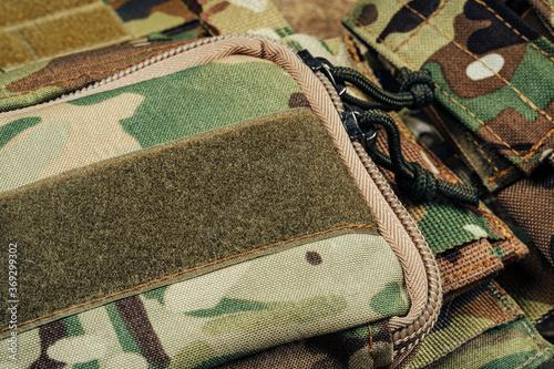 Obraz na plátně Military body armor on wooden background close up