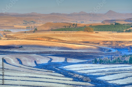 Canvas-taulu FIRE BREAK BURNING ETCHES THE LANDSCAPE  Ngagwana valley, southern drakensberg,