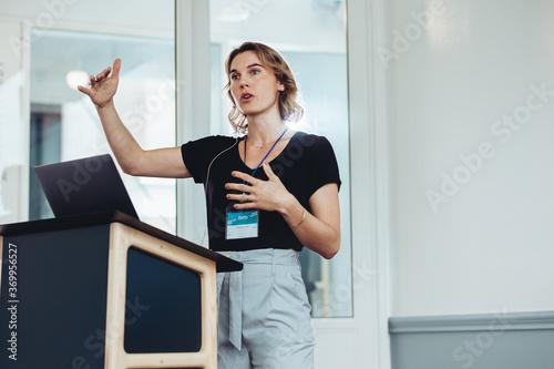 Fotografie, Tablou Businesswoman speaking from a podium