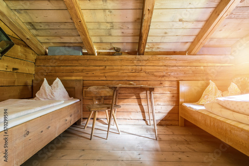 Holiday in the mountains: Rustic old wooden interior of a cabin or alpine hut Fototapeta