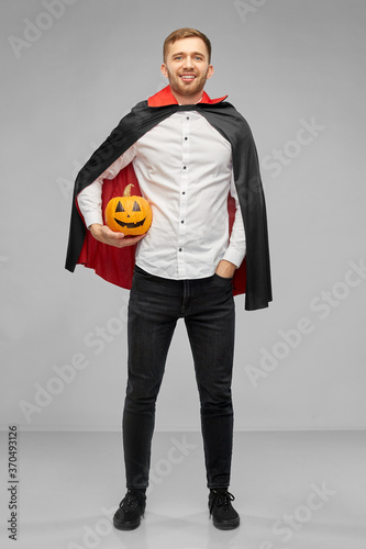 Fényképezés holiday and people concept - happy smiling man in halloween costume of vampire a