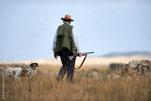 Photographie hunter with dogs