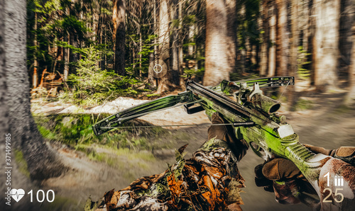 Fotografia First person view soldier in camouflaged suit with crossbow in forest