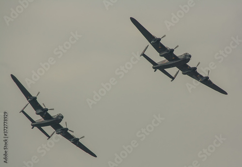 Stampa su Tela The last two remaining airworthy Avro Lancasters heavy bombers performing a duet
