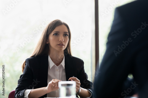 Young lady secretary or personal assistant listening carefully to boss instructi Fotobehang