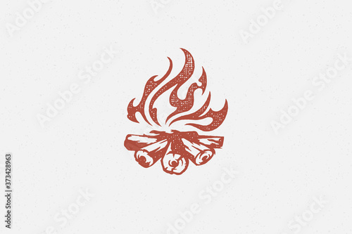 Fotografie, Tablou Red silhouette of hot campfire burning on logs on campsite hand drawn stamp effect vector illustration