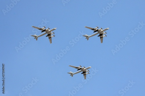 Canvas Print A group of Tu-95MS turboprop strategic bombers in the sky over Moscow during the