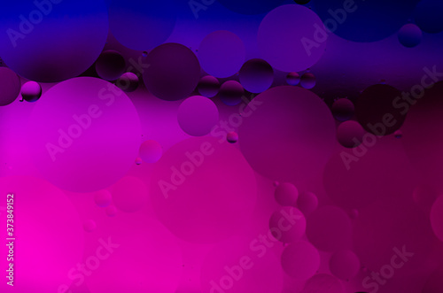 Oil in water illuminated by colorful LED light.