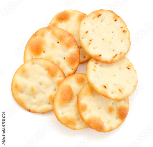 Fényképezés A stack of cheesy rice crackers on a white background.