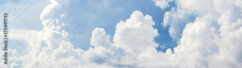 Panorama of blue sky with white clouds in sunny weather