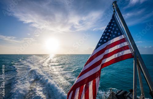 Fotografija American Flag and Sunrise Over Gulf of Mexico