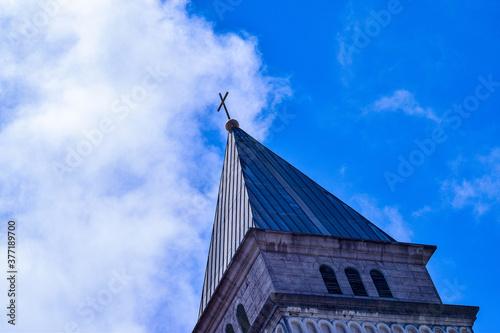 Wallpaper Mural church steeple against sky